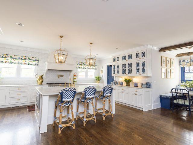 historic renovation gourmet kitchen with oversized functional island, pendant lighting, subway tile backsplash